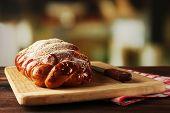 Fresh bun on table on bright background
