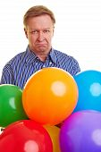 Sad Man With Colorful Balloons
