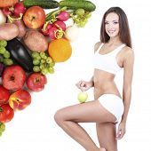 Beautiful young woman holding green apple isolated on white with fruits and vegetables in corner