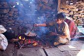 Nepalese Man Cooking