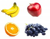 Fresh sliced orange fruit, Branch of blue grapes, Red apples and  bananas isolated on white backgrou