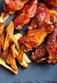 foto of chicken wings  - Sweet and sticky chicken wings with chips - JPG