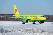 NIZHNY NOVGOROD. RUSSIA. FEBRUARY 17, 2015. Bright green A-319 plane of the s7 company