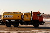 NIZHNY NOVGOROD. RUSSIA. FEBRUARY 17, 2015. Yellow fuel truck of the company Lukoil