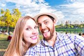 Beautiful Couple taking a selfie photo in the park