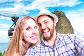 Beautiful Couple taking a selfie photo in Rio de Janeiro, Brazil