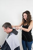 picture of trimmers  - Barber cutting and modeling hair by electric trimmer - JPG