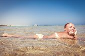 Beautiful woman laying in sea