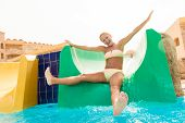 Young woman on a waterslide