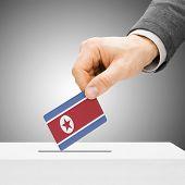 Voting Concept - Male Inserting Flag Into Ballot Box - North Korea