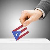 Voting Concept - Male Inserting Flag Into Ballot Box - Puerto Rico