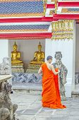 BANGKOK, THAILAND, DECEMBER 26, 2013: Buddhist monk in Wat Pho temple