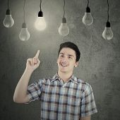 Caucasian Person Under Lightbulb