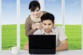 Couple Surfing Internet Online On Laptop