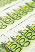many einhhundert euro banknotes are adjacent. photo icon for wealth and investment