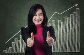 Excited Businesswoman Showing Thumbs Up 1