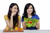 Friendly Girls With Vegetables Salad