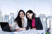 Two Businesswomen Working On Desk