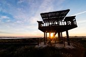 foto of observed  - Wooden wildlife observation watchtower against the background of a sunrise - JPG