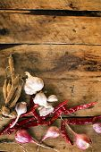 Red Hot Chili Peppers With Garlics, Red Onions And Fingerroots On Wooden Background