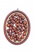 Conker Fruits Seeds In Wooden Picture Oval Frame Isolated