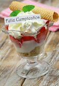 Feliz cumpleanos (which means happy birthday in Spanish) card with strawberry dessert