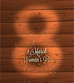 International Women's Day, 8 March. Wooden Background, Blurred Digit 8 and Label for Holiday Design.