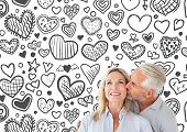 Affectionate man kissing his wife on the cheek against heart pattern