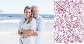 Happy couple hugging on the beach woman looking at camera against valentines pattern