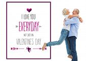 Mature couple hugging and having fun against valentines day greeting