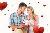 Couple with gift against hearts