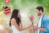 Happy hipster giving his girlfriend roses against digitally generated dandelion seeds on green background