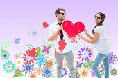pic of girly  - Hipster couple smiling at camera holding a heart against digitally generated girly floral design - JPG