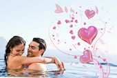 Couple hugging in the pool against valentines heart design