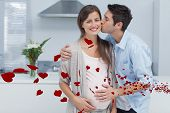 Man kissing his pregnant wife against red hearts floating