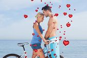 Cute couple together with their bicycles against red heart balloons floating