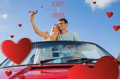 Cheerful couple standing in red cabriolet taking picture against always and forever