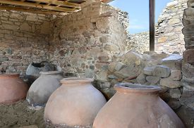 stock photo of minotaur  - old clay pot excavations into ancient city ruins - JPG