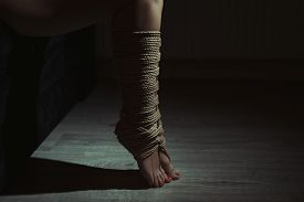 image of sadism  - Beautiful legs tied with rope in bondage - JPG