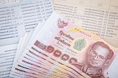 stock photo of paycheck  - Thai money on two Saving Account Passbook - JPG