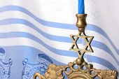 picture of sukkot  - Menorah in front of a blue and white tallit - JPG