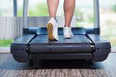 stock photo of treadmill  - Fitness girl running on treadmill - JPG