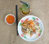 stock photo of nuong  - Pork grilled spring rolls and fresh sausages with rice noodle and vegetable Vietnamese typical cuisine so called BUN THIT NUONG - JPG