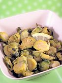 stock photo of brussels sprouts  - Roasted brussels sprouts in the bowl with a slice of a lemon - JPG