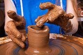 picture of pottery  - hands working on pottery wheel - JPG