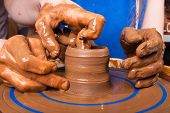 picture of train-wheel  - Potter trains to work on pottery wheel - JPG