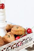 stock photo of cake stand  - Closeup of heart cookies and ripe cherries on white cake stand - JPG