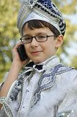 stock photo of circumcision  - Male child wearing cultural sultan costume before circumcision in Turkey. ** Note: Soft Focus at 100%, best at smaller sizes - JPG