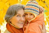 pic of granddaughters  - Grandmother with her granddaughter in the autumn park - JPG