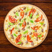 foto of leek  - Delicious seafood pizza with tuna fish tomatoes and leek  - JPG